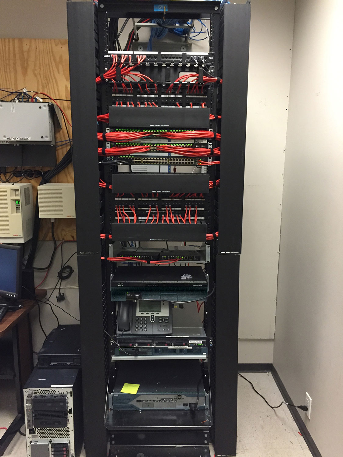 tall electrical unit with red wires